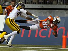BC lions wide receiver Taylor dives for the goal line as Hamilton Tiger-Cats defensive back Brown moves in during CFL football game in Vancouver. Larry Fitzgerald, Defensive Back, Wide Receiver, Lions, Football, Cool Stuff, Hamilton, Vancouver, Goal