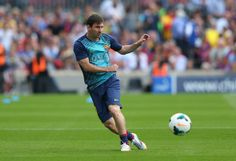 Lionel Messi of FC Barcelona warms up prior to the La Liga match between FC Barcelona and Club Atletico de Madrid at Camp Nou on May 17, 2014 in Barcelona, Catalonia.