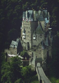 Eltz Castle | Photograph by yakonusuke |  Burg Eltz is a medieval castle nestled in the hills above the Moselle River between Koblenz and Trier, Germany.