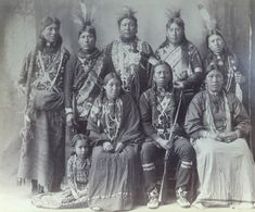 """Group of 9 (8 Omaha, 1 Otoe)"" - Photo by Frank A. Rinehart, on the occasion of The Indian Congress occurred in conjunction with the Trans-Mississippi International Exposition of 1898, in Omaha, Nebraska, USA - (Original)"