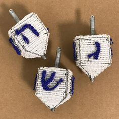 Our Sustainable wire and bead dreidel is beautifully hand crafted by artisans in South Africa.  http://globalgoodspartners.org/products/wire-art-beaded-dreidel