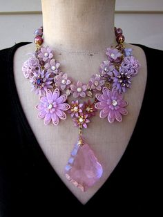 RESERVED FOR NONI Vintage Flower Statement Bib by rebecca3030. Currently reserved for someone but still a beautiful piece and I love purple. Bib statement necklace is comprised of vintage celluloid, lucite, enamel and rhinestone flowers in mauve and fushia hues.