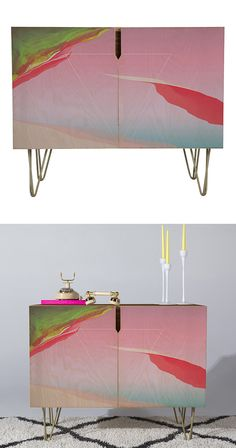 We give up trying to figure out what the designer of this Presley Credenza had in mind. We're enamored of the fabulous color palette, which…