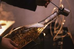 Liqueur d'expedition -what a darling dunking ladle to plunge the right measure and pour confidantly