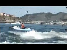 Humpback Whale Scares Kayakers in Avila Beach, surfacing whale nearly lands on kayakers in dramatic video captured off San Luis Obispo coast. San Luis Port Harbor Patrol is concerned for safety of boaters, kayakers, SUP boarders & all others trying to get close-up video or photos of vertical feeding whales. Hefty fines await those people refusing to stay 100 yds away from whales. (David Strege/GrindTV/Y! Sports) 8/21/12