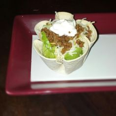 Mini taco bowls from a 6in tortilla baked in a jumbo muffin tin in a 350° oven for 13 minutes