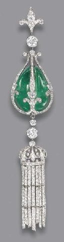 A BELLE EPOQUE EMERALD AND DIAMOND PENDANT. The drilled emerald bead within the…