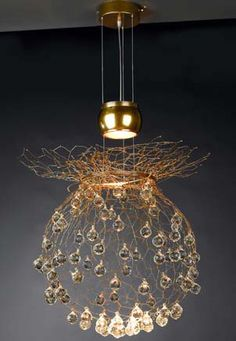 A similar effect could be created using chicken wire and old chandelier crystals. It would be pretty suspended from a tree branch too (obviously not electrified).