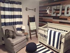 Rustic Woodland Nursery featuring a fab rustic wall and navy and white stripes - adorable!