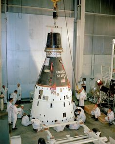 The Gemini 11 spacecraft is lowered onto a dolly for preflight maintenance before stacking on the Titan rocket at the Kennedy Space Center. Dick Gordon and Pete Conrad would liftoff in this spacecraft on September 12, 1966 for a mission lasting almost three days. The crew practiced docking with the Agena unmanned docking craft, and Gordon also performed two spacewalks during the mission.