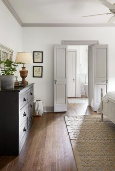 White walls with warm light gray trim. The Scrivano House from Fixer Upper Bedroom decor Bedroom Doors, Home Decor Bedroom, Bedroom Furniture, Modern Bedroom, Diy Bedroom, White Bedroom Door, Light Gray Bedroom, Taupe Bedroom, Farm Bedroom
