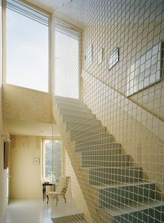 Net railing adds great dimension to the room Tham Videgard Net Stairwell   Remodelista