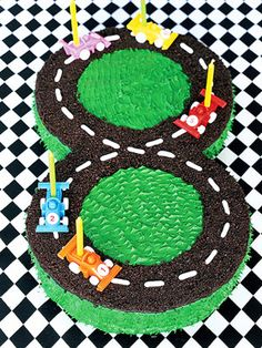 Chocolate cookie crumbs make the race track for this dessert. If your child loves cars, this cake will be a favorite.
