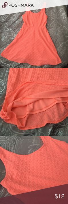 """Skater dress Only worn one time, in photo above for my Prek-ers graduation. Good condition. Lined. 98% polyester 2% spandex. Falls just above my knees and I'm 5'5"""" The color is a bright pink/peach/orange kinda color. Mossimo Supply Co. Dresses"""