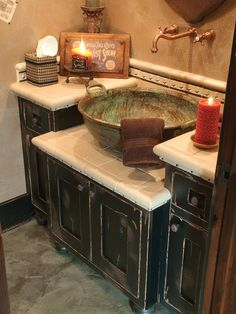 Old-world Bathrooms from Larry Pearson on HGTV Lovely mix of materials, especially the beautiful patinated bowl sink.