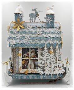 """The winner of December's mood board challenge..! Wonderfully altered little """"Maja house"""", by Nicola. Papers from MajaDesign's """"Vintage Frost Basics"""" collection."""