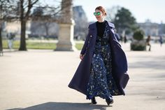 A floor-length maxi like Christene Barberich's only looks more dramatic with a floor-length coat.