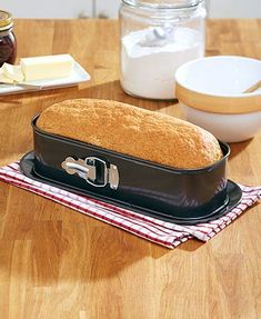 Create perfectly shaped baked goods with this Springform Loaf Baking Pan.  Featuring a zinc, nonstick coating and a tin body for even heating throughout, this baking pan has a latch on the front opens and closes easily, and the tray on the bottom holds your baked creation after it's finished and is also freezer and oven safe.  Get yours today for yourself or as a gift for mom.