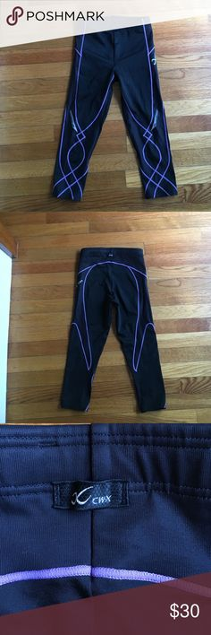 CW-X Compression Stability 3/4 Tights CW-X Compression Stability 3/4 black/purple tights, size Small. Targeted joint support in knees, hips & core for overall stability and balance. Worn a couple times. Missing string that goes around waist on the inside. CW-X Pants Leggings