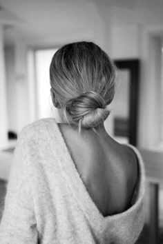 Pulled back bun with hair draped in front.