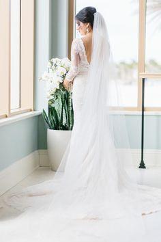 Deep V lace 3/4 sleeve wedding dress: http://www.stylemepretty.com/florida-weddings/clearwater/2017/03/30/classic-black-white-wedding/ Photography: K & K - http://www.kandkphotography.com/