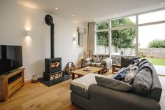 The spacious lounge at 1 The Sands has garden views and a log burner for cosy evenings in. North Cornwall, Log Burner, Private Garden, New Builds, Sands, Cosy, Catering, Lounge, Cottage