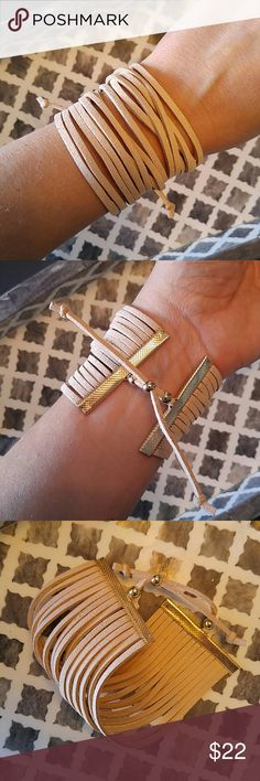 Multi layered tan suede pull tie bracelet Love this. Tan with gold tone hardware. So versatile. Simply pull the ends of the tie to adjust. Faux suede. Jewelry Bracelets