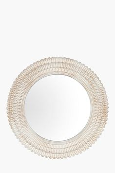 This round mirror with scallop detail will compliment any interior.