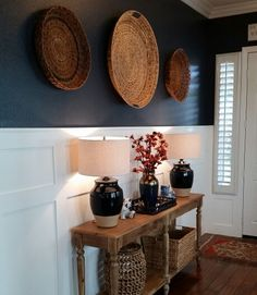 Entryway Benjamin Moore paint Hale navy decor ideas interior design Everette table world market baskets navy Lamps board and batten