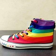 Product details Make a statement with the awesome Rainbow canvas shoes. Closure Type: Lace-UpUpper Material: CanvasInsole Material: Rubber Sizing chart Shipping