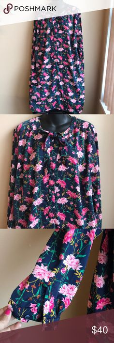 Floral plus Sz XXL shirt dress Beautiful floral print shirt dress with tie up around neck . Long sleeves . The fabric feels super soft to touch almost like silk . Dress is lined . 100% polyester. No tags Dresses Midi