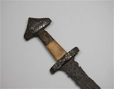 Viking aged double-edged sword with silver and copper decorations. Uppland, Sweden.