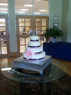 pink and navy wedding cake by Artisan Kitchen, via Flickr