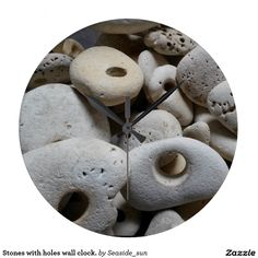 Stones with holes wall clock.