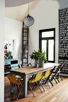 love the mix of modern and industrial. thinking the subway art panel would be great in our dining room....