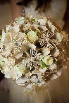 This crafty bride carried the pages of her favorite book down the aisle in a paper flower bouquet.