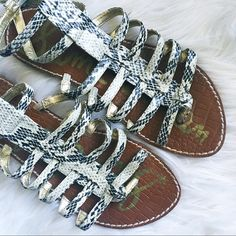 Sam Edelman Snakeskin Gladiators  Gorgeous gladiator sandals by the beloved Sam Edeman! Gold lining and snakeskin outer, these sandals are a perfect statement piece for summer! They have a little bit of general wear but are in awesome condition! Lots of life left in these! Pair with shorts and a loose white tee or wear out with a LBD! Make me an offer! Sam Edelman Shoes Sandals