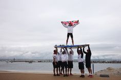 Nick Dempsey of Great Britain is carried onshore on his windsurf board by Team GB team mates after winning the silver medal in the RS:X Men's Sailing on Day 11 of the London 2012 Olympic Games at the Weymouth & Portland Venue at Weymouth Harbour on August 7, 2012 in Weymouth, England. (Photo by Getty Images)The Day's Best | 08.07.12 - Nation/World - NewsObserver.com