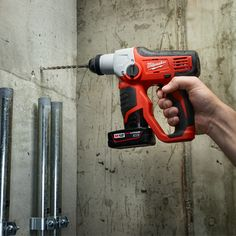 """The Milwaukee® M12™ Cordless ½"""" SDS Plus Rotary Hammer 2412-22XC is one of the lightest available, coming in at 3.9-pounds and 9-inches in length. Its compact size is ideal for drilling in tight spaces and all-day use."""