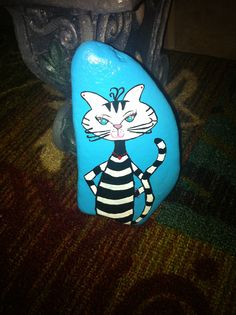 Sassy Cat painted on a rock