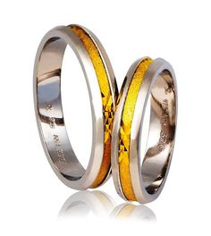Check out this item in my Etsy shop https://www.etsy.com/listing/470150994/silver-and-gold-wedding-band-rings