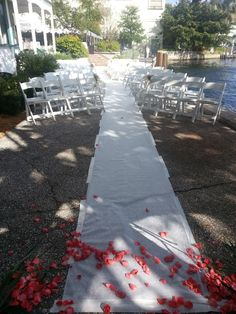 White carpet leading up the altar under the sea grape at the Historic Stranahan House Museum