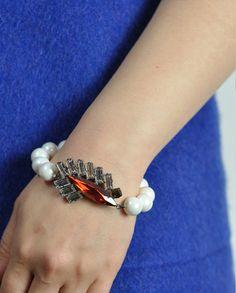$100 Red Pearls Swarovski Crystals Embellished Wing Bracelet by Miss Julie  Shop here: http://www.trendcy.com/red-pearls-swarovski-crystals-embellished-wing-bracelet/