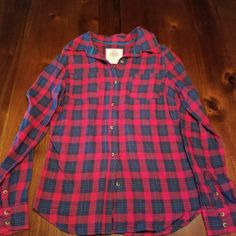 Plaid Red & blue stripe collar shirt Red & blue collar shirt 100% cotton with brown buttons 🌺no holes 🌺 no stains 🌺 it's  a medium but fits like a small  🍉 hit the offer button  🍉 SO Tops Button Down Shirts
