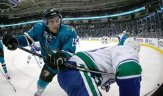 San Jose Sharks forward James Sheppard battles for the puck against Vancouver Canucks forward Shawn Matthias (Dec. 30, 2014).