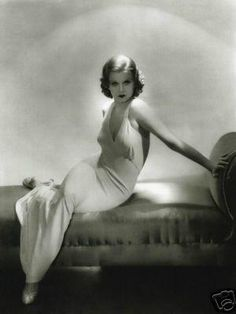 """Jean Harlow wore this white satin, bias-cut gown in the 1933 classic, Dinner at Eight. It was such a fashion hit that the style became known as """"The Jean Harlow Dress."""" But Harlow was probably the only one who had to be sewn into it, sans underwear."""