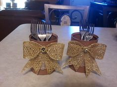 Utensil holders. tin cans spray painted and added dollar store bows and ribbon