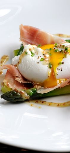 This poached duck egg recipe with asparagus by Matthew Tomkinson is a fantastic way to celebrate the English asparagus season. The grain mustard dressing used here is also fantastic to use in salads and other dishes that could use a bit of an extra punch.