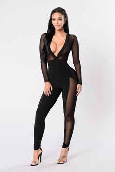 - Available in Black - Long Sleeve Jumpsuit - Mesh Top and Inset on Legs - Skinny Fit - Plunging Neck and Back Line - Back Tie Detail - Made in USA - 90% Nylon 10% Spandex