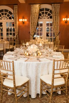 Gold and White Round Reception Table | Pretty Little Details | Angela Newton Roy Photography https://www.theknot.com/marketplace/angela-newton-roy-photography-new-york-ny-543702
